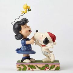 Mistletoe Mischief-Snoopy Kissing Lucy Under Mistletoe Figurine