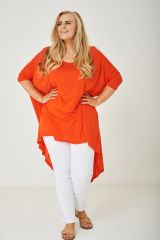 PLUS SIZE DIP HEM LONGLINE TOP IN ORANGE