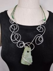 Aluminum Swirls, Green Leather and Light Green Rough Cut Stone Necklace