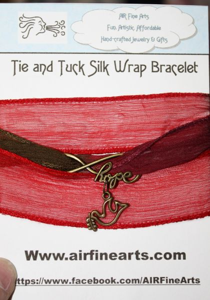 """Hues of Ruby Red Silk """"Tie and Tuck"""" Wrap Bracelet Embellished with Bronze Infinity Hope and Dove of Peace Charms"""