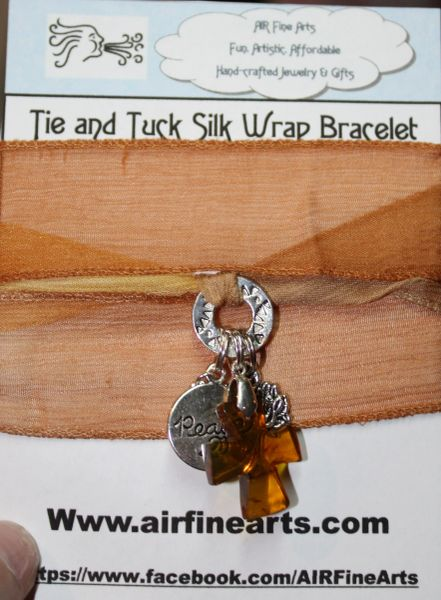 "Hues of Camel Brown Silk ""Tie and Tuck"" Wrap Bracelet Embellished with Amber Cross and Silver Peace and Tree of Life Charms"