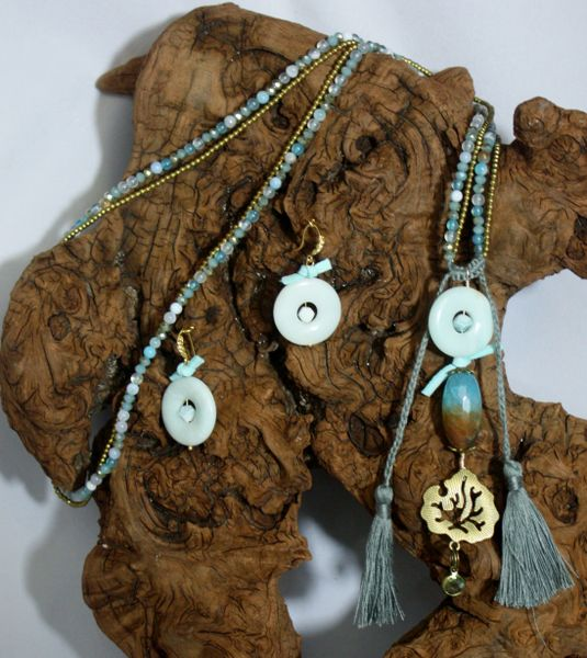 Light Aqua Hue Agate with a Druzy pendant accentuated with suede knot details and jeweled charm