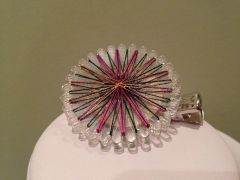 Thread wrapped brooch