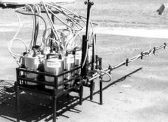T-6 -Tractor mounted sprayer with six 3gal. treatments and 8 nozzle boom