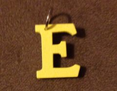932. Wood Letter E Pendant