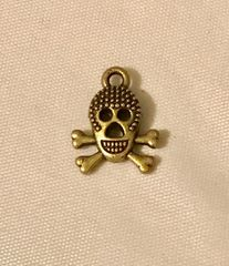 1699. Elongated Skull on Crossbones pendant