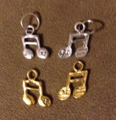 557. Double Music Note Pendant