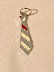 1785. Tie Pendant