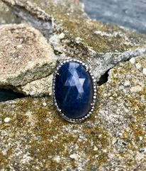 Blue Sapphire Oval Ring with Diamond Surround