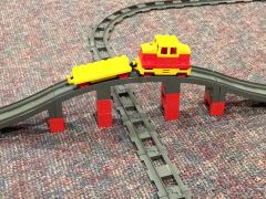 sp150 motorized engine,flat car, bridge trestle, tracks