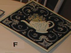 Metal tile with tea pot