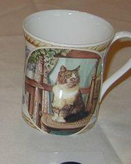 White and brown cat sitting mug