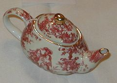 Small collectible tea pot red toile