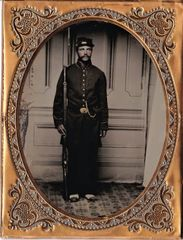 Near Mint Ambrotype of Soldier with Enfield