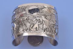 "Navajo dead-pawn sterling silver ""storyteller"" cuff"