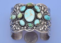 Sterling Navajo cluster cuff with mixed-color turquoise by Gilbert Tom.