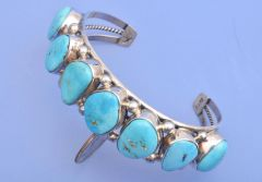 Dead-pawn Navajo seven-stone Sterling cuff with Kingman turquoise.
