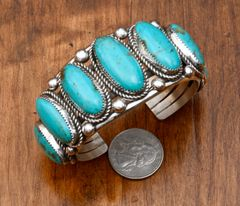 Seven-stone Navajo Sterling cuff with Kingman turquoise