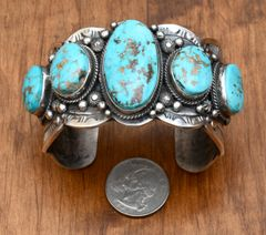 Massive Navajo Sterling cuff with five Kingman turquoise stones by Gilbert Tom.