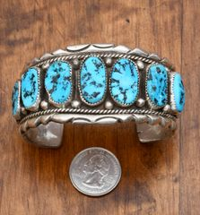 Dead-pawn Navajo classic Sterling cuff with seven Sleeping Beauty mine turquoise stones.