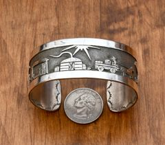 "Dead-pawn Navajo Sterling storyteller cuff by ""Harvey.""—SOLD!"
