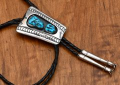 Navajo dead-pawn Sterling bolo tie with custom tips and Sleeping Beauty turquoise.—SOLD!