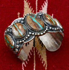 Navajo heavy-silver cuff with five boulder/ribbon turquoise stones, by Gilbert Tom.—SOLD!