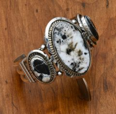 Sterling Navajo triplet cuff with white buffalo stones by Augustine Largo.—SOLD!