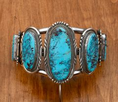 Elaborate dead-pawn Navajo Sterling cuff with five large Kingman turquoise stones.