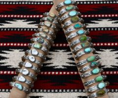 Inexpensive Navajo Sterling cuffs with various Nevada-mined turquoise by Gilbert Tom.