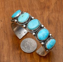 Dead-pawn heavy silver Navajo cuff with five Kingman turquoise stones by Sheila Tso.