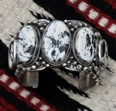 Heavy silver Navajo five-stone cuff with White Buffalo stones, by Gilbert Tom.