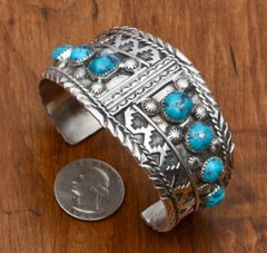 Man's or woman's Navajo dead-pawn Sterling cuff with eight turquoise stones.