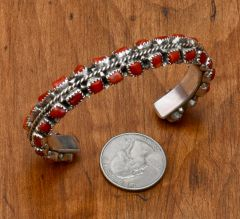 Dead-pawn Sterling Navajo cuff with 38 pieces of Mediterranean red coral.