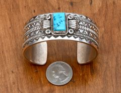 Navajo dead-pawn Sterling cuff with single Sleeping Beauty turquoise stone.