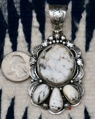 Navajo Sterling pendant with four white buffalo stones by Lester James.