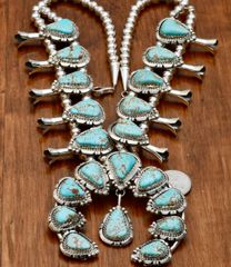 Custom-made squash blossom necklace with No. 8 Mine turquoise by Augustine Largo, Navajo.—SOLD!