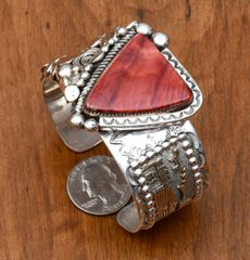 Sterling and gold-fill Navajo cuff with spiney oyster shell by Roger Nez.—SOLD!
