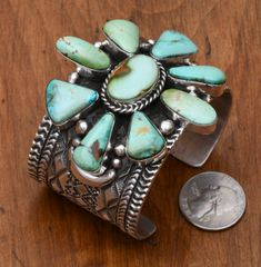 Navajo Sterling cluster cuff with eight Royston, Nevada turquoise stones, by Tillie Jon.