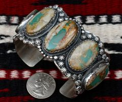 Heavy silver Navajo cuff with five boulder/ribbon turquoise stones, by Gilbert Tom.—SOLD!
