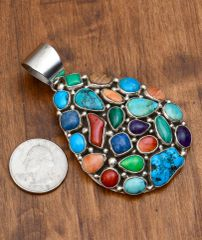 Sterling multi-stone cluster pendant by Emer Thompson, Navajo.—SALE PENDING
