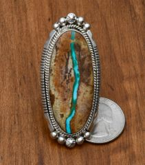Sterling Navajo ladies ring with ribbon (boulder) turquoise by Alonzo Largo.