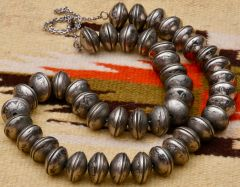 Very vintage dead-pawn 33-inch Navajo pearl necklace made with 88 old Indian-head nickels