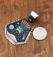 Intricate inlaid pendant by Michael Jack.