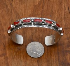 Navajo Sterling cuff with nine pieces of Mediterranean branch coral by Victoria Yazzie.