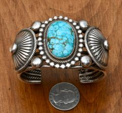 Navajo Sterling cuff with water-web Kingman turquoise and silver conchos, by Rick Martinez.
