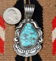 Nicely stamped Navajo Sterling pendant with larger bale by Albert Jake.