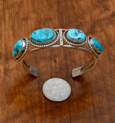 Dead-pawn Navajo cuff with four Sleeping Beauty turquoise stones.—SOLD!