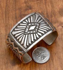 Heavy-stamped Sterling Navajo cuff by Elvira Bill.
