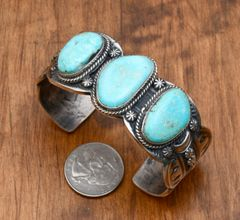 Navajo triplet cuff with Turquoise Mountain turquoise by Gilbert Tom.—SALE PENDING